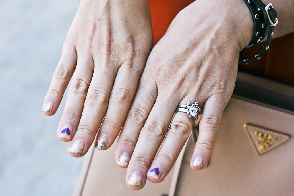 This woman even brought the party to her nails, pairing purple hearts with a sweet gold shimmer. Photo by Caroline Voagen Nelson