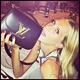 Poppy Delevingne got cozy with her Louis Vuitton bag for this photo op. Source: Instagram user poppydelevingne