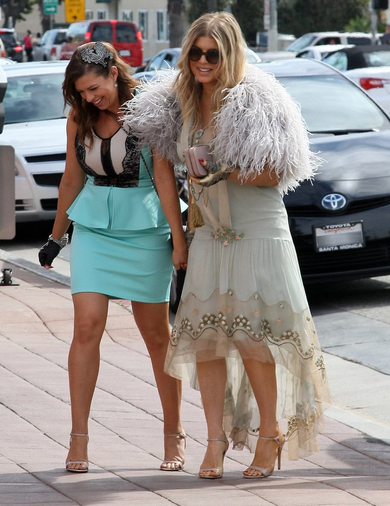 Fergie held onto her younger sister Dana's hand as they arrived at the Ivy in Santa Monica, CA, Saturday. They were dressed up to attend Dana's bridal shower, which had a French garden party theme and was scheduled just ahead of Dana's April wedding to fiancé Ryan Sampson. Fergie shared her excitement about the event on Twitter and posted pictures to Instagram of herself and Dana posing inside the restaurant. The fun will continue even after Dana ties the knot since Fergie will welcome her first child with husband Josh Duhamel later this year. The couple announced their big news last month and showed off their joy during a recent trip to London, where Josh pulled double duty vacationing and promoting Safe Haven with Julianne Hough. Fergie then continued on to Milan and Paris to attend the Fashion Week festivities.
