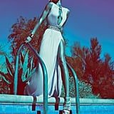 Gisele wows in a floor-length keyhole Versace gown poolside. Source: Fashion Gone Rogue