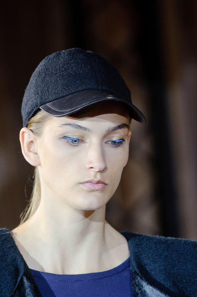 Models wore baseball caps with ponytails looped through on the Didit Hediprasetyo runway, but the blue eye makeup and eerie silver contacts gave the look a futuristic air.