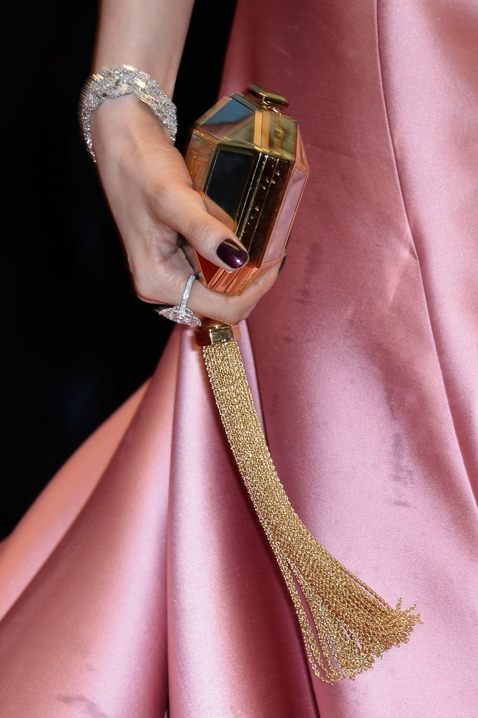 Fan Bingbing carried a glitzy hexagonal clutch and wore Chopard diamond jewelry.