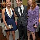 Olivia Munn laughed with B.J. Novak and Ellie Kemper.