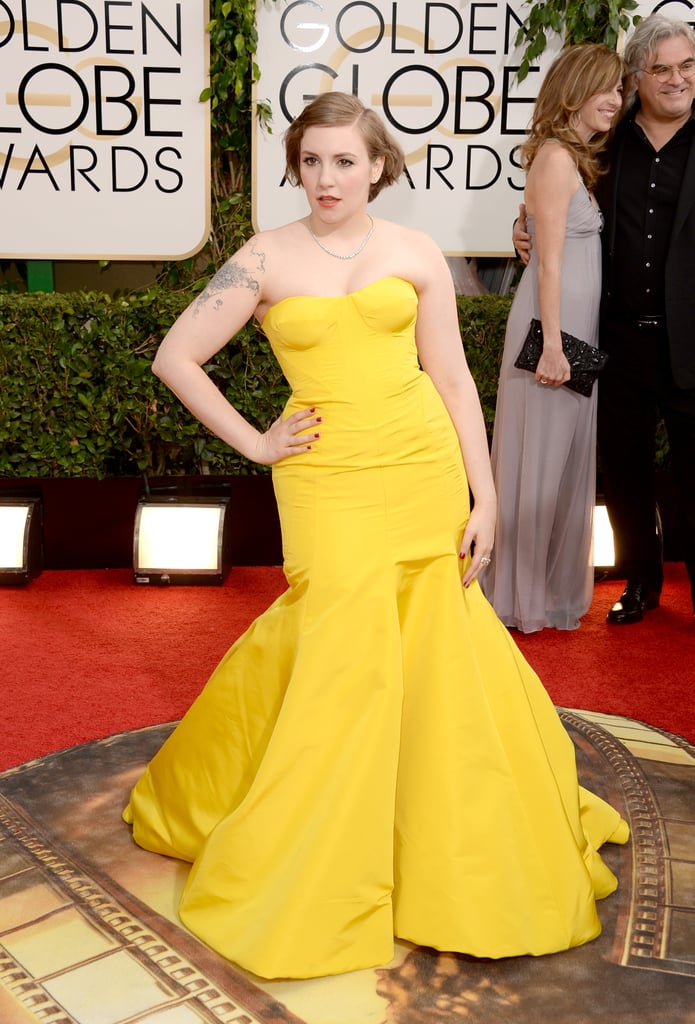 Lena Dunham made her arrival at the Golden Globes in LA wearing a bright yellow Zac Posen gown and a swept-back hairstyle. Lena was her usual smiley self as she posed for photos. It's a big night for Lena and her Girls co-stars; not only is the show up for a best TV series award, but also, Girls premieres its third season tonight on Showcase and has been renewed for a fourth! Lena and the ladies stepped out to celebrate the show's return last week at a party in NYC, and she and Allison Williams talked up the new season with a stop at Good Morning America. While we wait to see if Lena takes the stage to accept a Golden Globe, keep reading to see photos from her trip down the red carpet.
