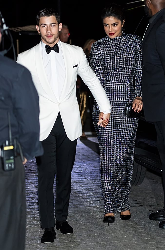 When Priyanka Chopra walks into a room, it's filled with glamour. She continues to prove that point time and time again, especially during each date night she takes with fiancé Nick Jonas. The stunning duo recently walked the red carpet together for Ralph Lauren's 50th anniversary celebration at New York Fashion Week, and she chose a gorgeous gown for the occasion. Her floor-length, crystal-embellished Ralph Lauren dress is the perfect balance of modest and sexy, as it cuts a skintight figure. Even more magical? The crystals shine under direct light giving Priyanka's outfit a celestial appearance. We're all just orbiting in her sphere! Ahead, see Priyanka's dress from all angles as she walks hand-in-hand with her handsome date (who's decked out in a suave Ralph Lauren ensemble of his own).