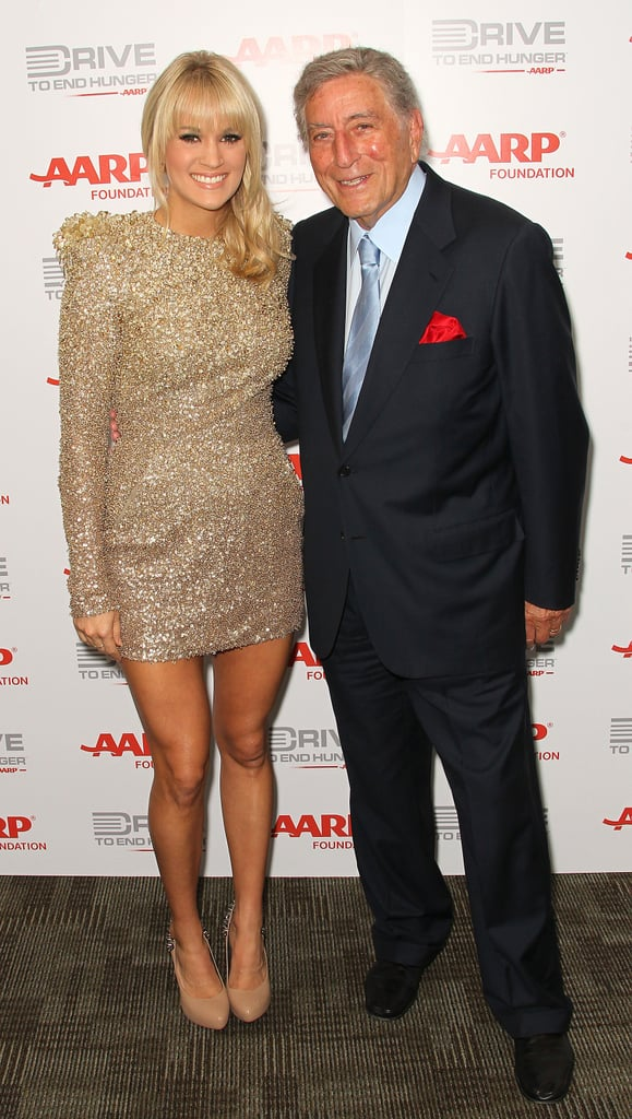 Carrie, in a gilded creation, snuggled up to Tony Bennett at a September 2011 event.
