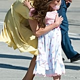 Kate Middleton hugged a sweet 6-year-old girl at the Calgary Airport during the royal couple's North American tour in July 2011.