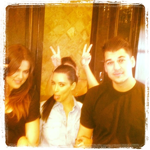 The Kardashians got playful while snapping a group photo.  Source: Instagram user kimkardashian