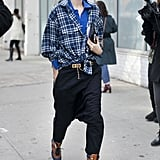 Taylor Tomasi Hill crafted cool layers with plaid, shades of brilliant blue, and laid-back trousers — one part punk, all parts chic.
