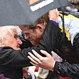 Harry hugged a 97-year-old woman in the pouring rain at The Rocks during his 2018 visit to Sydney.