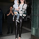 Miranda Kerr wore one of her favorite pairs of leather pants while Flynn Bloom kept it casual in a hoodie during their February 2012 departure out of LAX.
