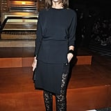 We spy a seriously cool pair of lace leggings beneath Carine Roitfeld's black silk sheath at Givenchy.