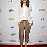 Allison went the casual route for a Girls event in suede trousers, nude-colored pointed-toe pumps, and a slightly sheer blouse.