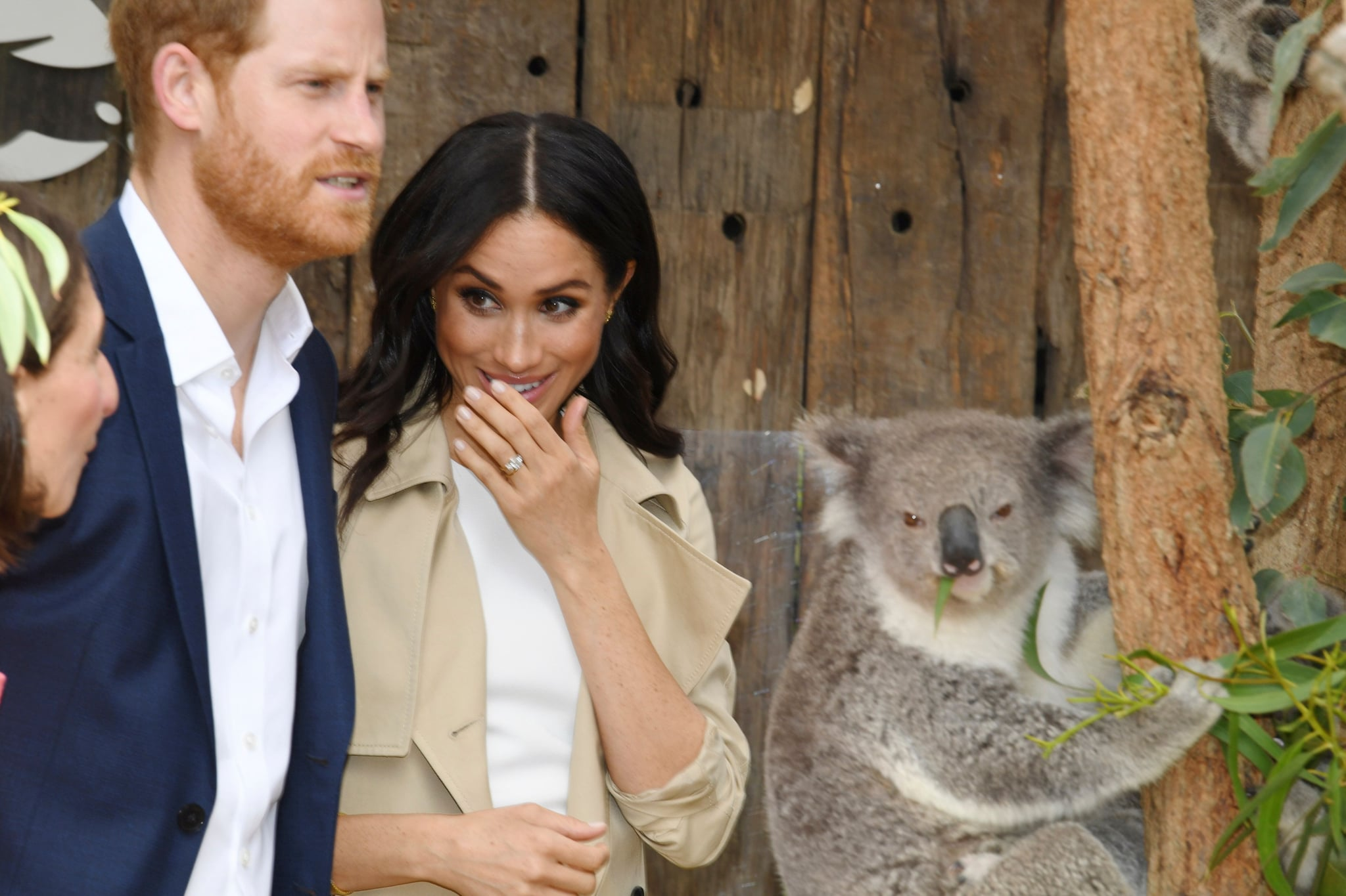 Britain's Prince Harry and his wife Meghan meet a koala named Ruby and its koala joey named Meghan after the Duchess of Sussex during a visit to Taronga Zoo in Sydney on October 16, 2018. - Prince Harry and Meghan have made their first appearances since announcing they are expecting a baby, kicking off a high-profile Pacific trip with a photo in front of Sydney's dazzling Opera House and posing with koalas. (Photo by DEAN LEWINS / POOL / AFP)        (Photo credit should read DEAN LEWINS/AFP/Getty Images)