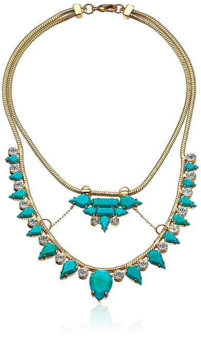 A pop of turquoise with this Noir necklace ($60) brings color to your outfit.