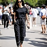 All-black feels anything but boring when a simple t-shirt, heels, and embellished jeans are at play.