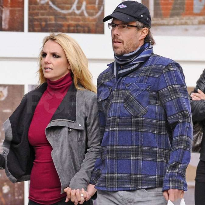 Newly engaged Jason Trawick held hands with Britney Spears.