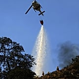 A helicopter dropped water on the wildfire in Glendora.