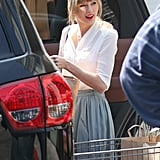 Taylor Swift packed up her car after grocery shopping solo in LA.