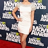 For the 2011 MTV Movie Awards, Emma wore a Marchesa dress with Brian Atwood shoes.