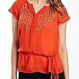 A bright tangerine shade makes this peplum top a fun, office-appropriate pick.  a.n.a. Split Neck Peplum Blouse ($18)