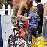 Kate Hudson picked little Bingham up out of his toy car.