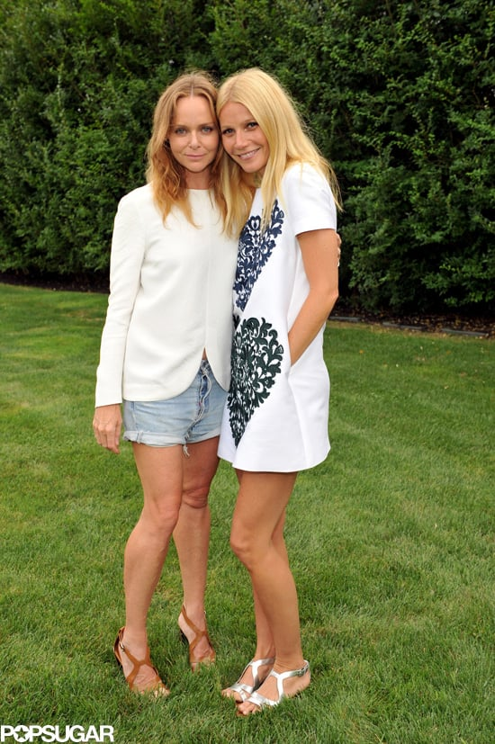 Most recently, at a Goop garden party in the Hamptons, Stella McCartney and Gwyneth Paltrow practiced their pose in style. Stella opted for denim cutoffs and a white top, and Gwyneth chose a white printed minidress with silver metallic sandals.