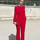Lady in red got a sleek makeover in a slim jumpsuit.