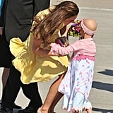 Kate received flowers from 6-year-old Diamond Marshall during a Make a Wish Foundation visit in Canada in July 2011.