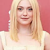 Attending the photocall for Night Moves, Dakota Fanning opted for a fresh-faced look with her straight hair worn with a middle part.