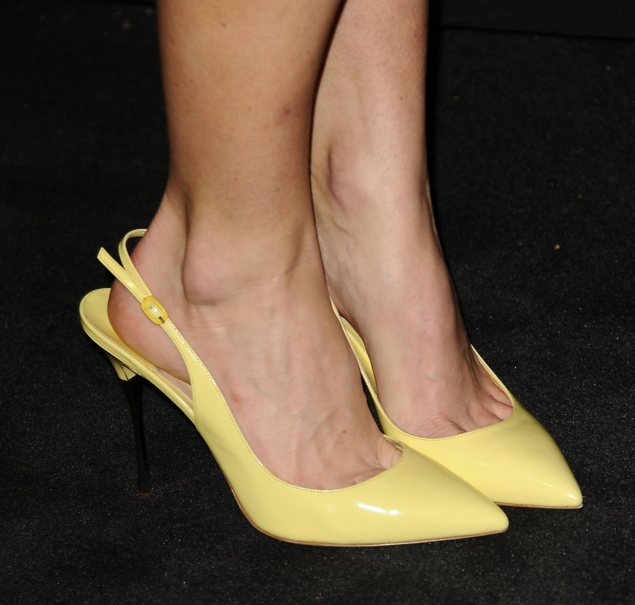 Alice Eve's colorblocked dress got a splash of sunlight from her yellow slingback pumps at the Chanel bash.