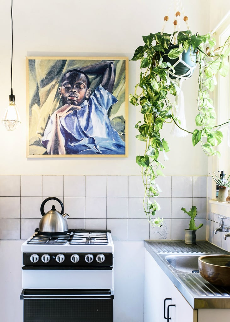"The eye-catching painting above the stove is a print of Izabella Godlewska de Aranda's ""Sleeping Boy."""