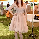 Coco Rocha dressed up in a nude Dennis Basso creation, complete with a pretty petal skirt and an embellished bodice.
