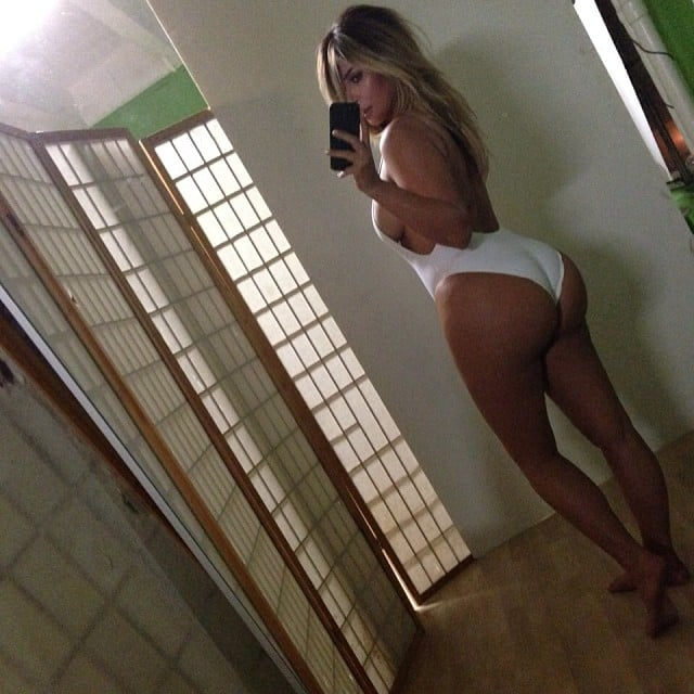 She flaunted her postbaby figure in a white swimsuit in October 2013. Source: Instagram user kimkardashian