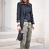 This take-your-cargo-pants-to-work look relies on understated separates, simple, functional footwear, and a blazer to tie it all together.