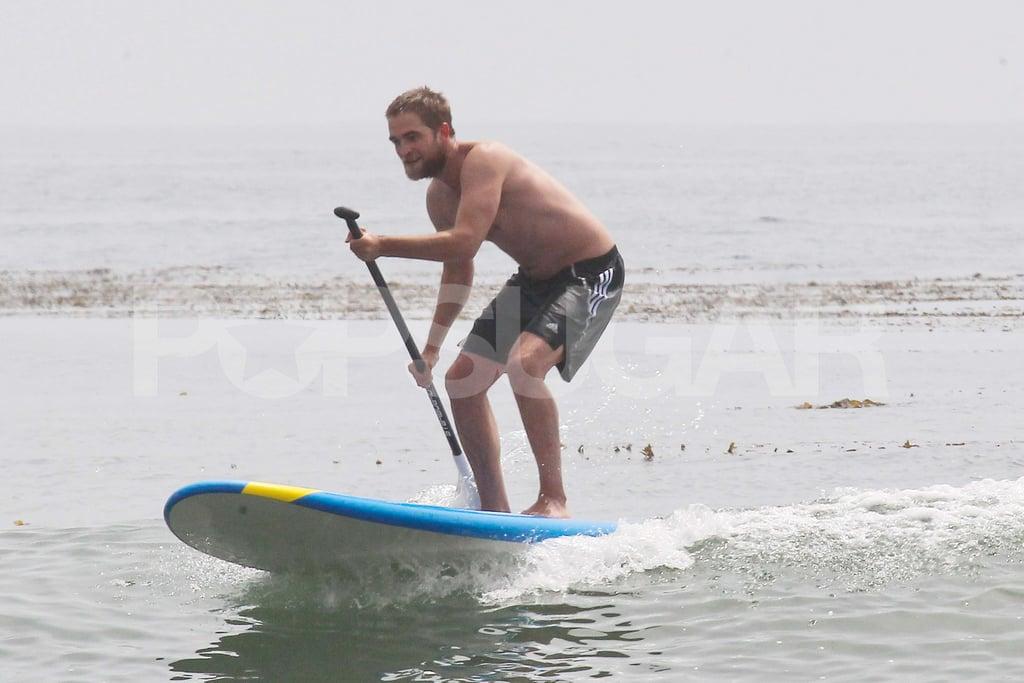Robert Pattinson went paddleboarding shirtless.