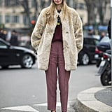Fur, burgundy, and a touch of tangerine all worked surprisingly well together in this eclectic outfit. Source: Le 21ème | Adam Katz Sinding