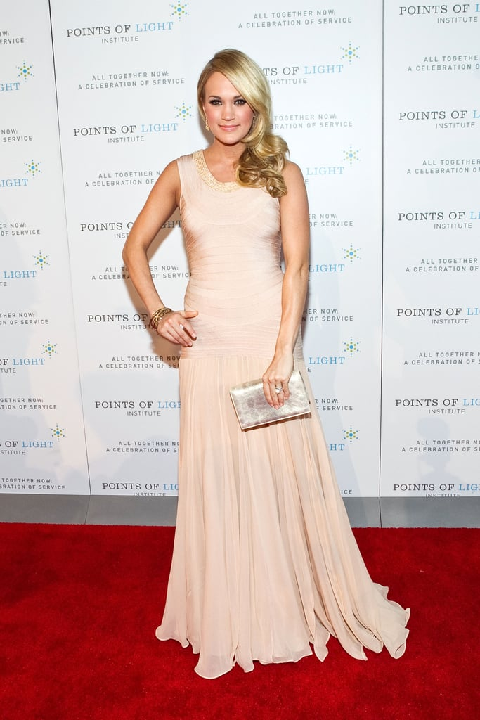 Carrie Underwood wore a nude Herve Leger gown to the Points of Light Institute's salute to President George H. W. Bush in Washington DC last night. The event brought together four presidents including both Bushes, Clinton, as well as Carter, and included performances by music industry stars Carrie, Sheryl Crow, Cee Lo Green, and Garth Brooks. Carrie will take the stage again next month at the Academy of Country Music Awards, which special guests Robert Pattinson and Reese Witherspoon are also expected to attend. The costars will be presenters at the ceremony as part of promotion for their upcoming film, Water For Elephants. Rob already kicked off his press tour with a stop by The Tonight Show, though Reese is perhaps more focused on her possible wedding this weekend. Carrie has her own movie to start showing off with Soul Surfer out on April 8, but you can catch an earlier glimpse of the artist when the Bush tribute airs on NBC next Monday.