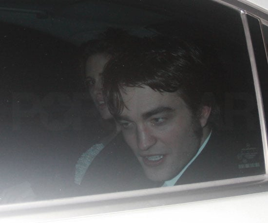 Slide Photo of Kristen Stewart and Robert Pattinson In a Car Together