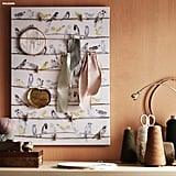 This wall art ($20) also serves as a cool board for pictures, recipes, and other ideas. Wait . . . that sounds familiar.