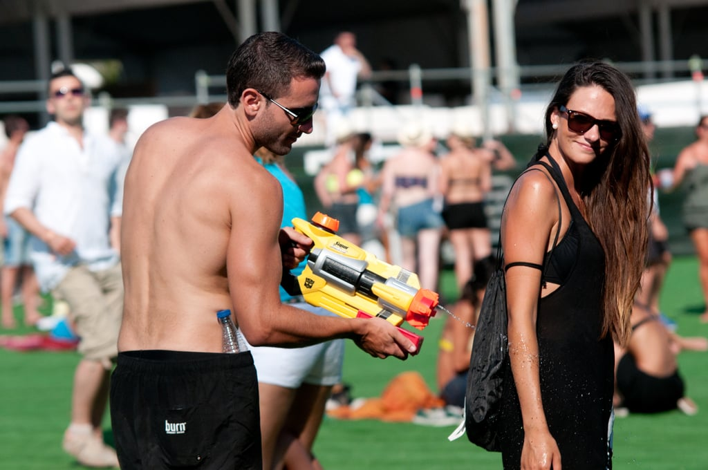 A guy goofed off with his lady friend at Ibiza 123 Festival: Rocktronic Sunset Strip in Ibiza, Spain.