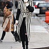 The Bag Blended Seamlessly With Her Striped Trench, Too