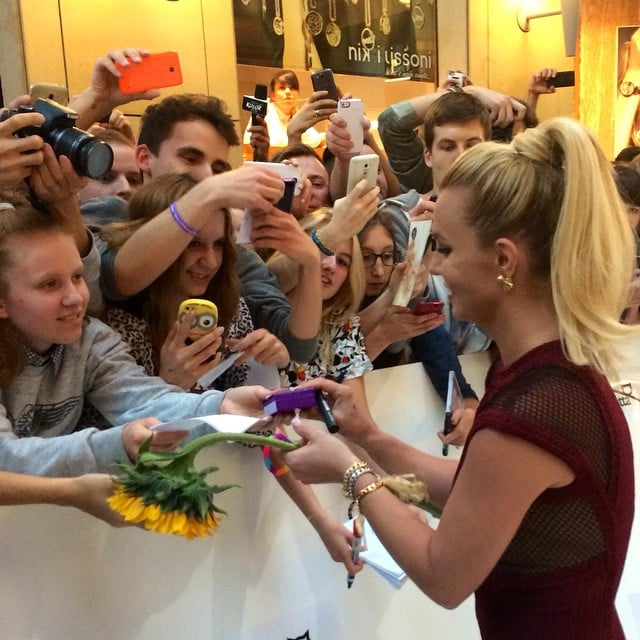 She's even signing autographs.