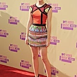 Emma Watson hit the MTV VMAs in September 2012 in this teeny-tiny Peter Pilotto minidress, which she paired with black strappy heels and minimal accessories.