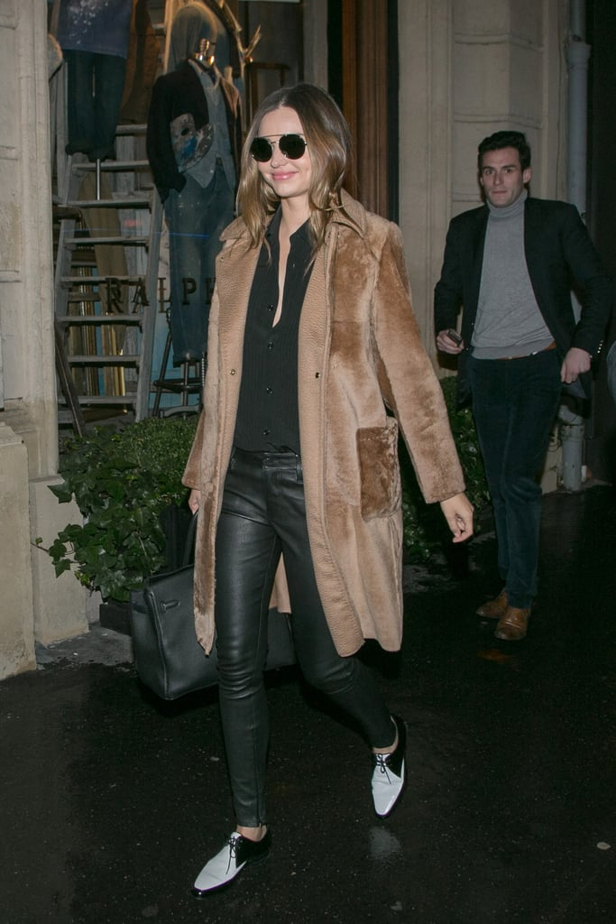 For a wintry outing in Paris, she picked a light brown furry coat to top her GENETIC leather pants. We love the two-tone flats, too!