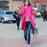 If you want all eyes on your designer sneakers, work your entire outfit around them, finishing with outerwear that plays up the colorway of your shoes.