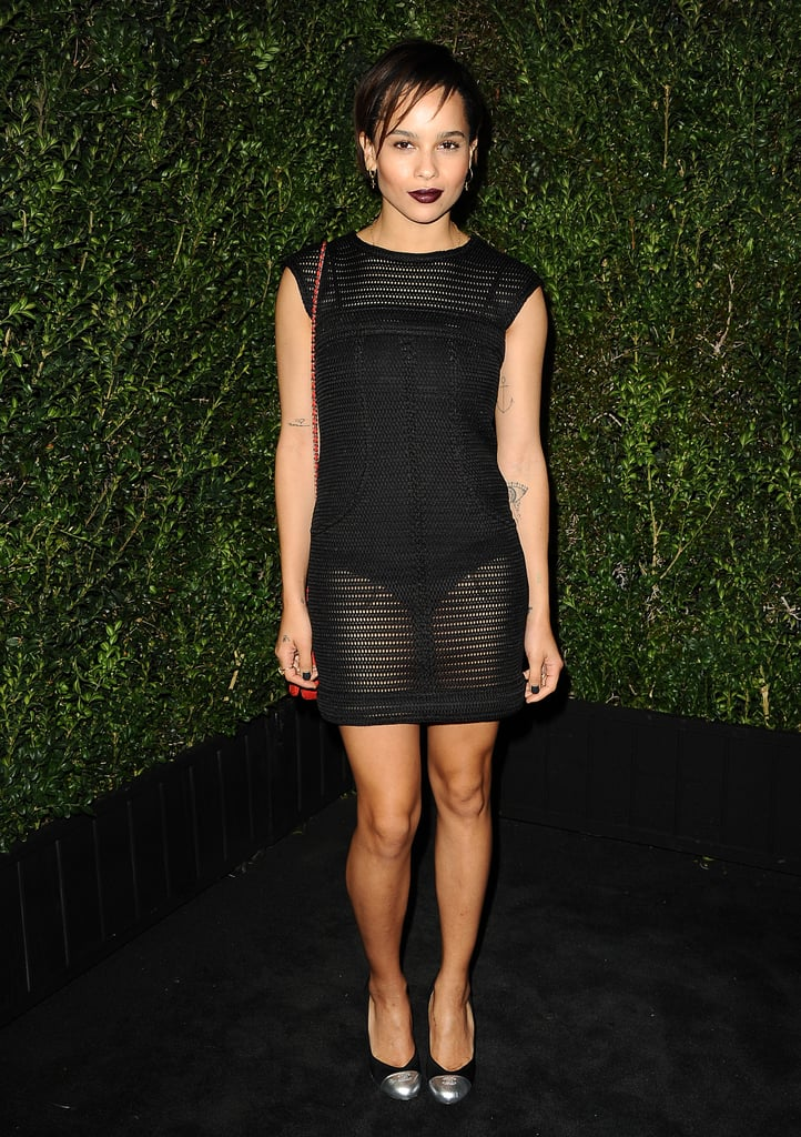 At the Chanel dinner, Zoë Kravitz went sheer and sexy in a see-through black Chanel minidress, pairing the revealing LBD with an equally dark lip color.