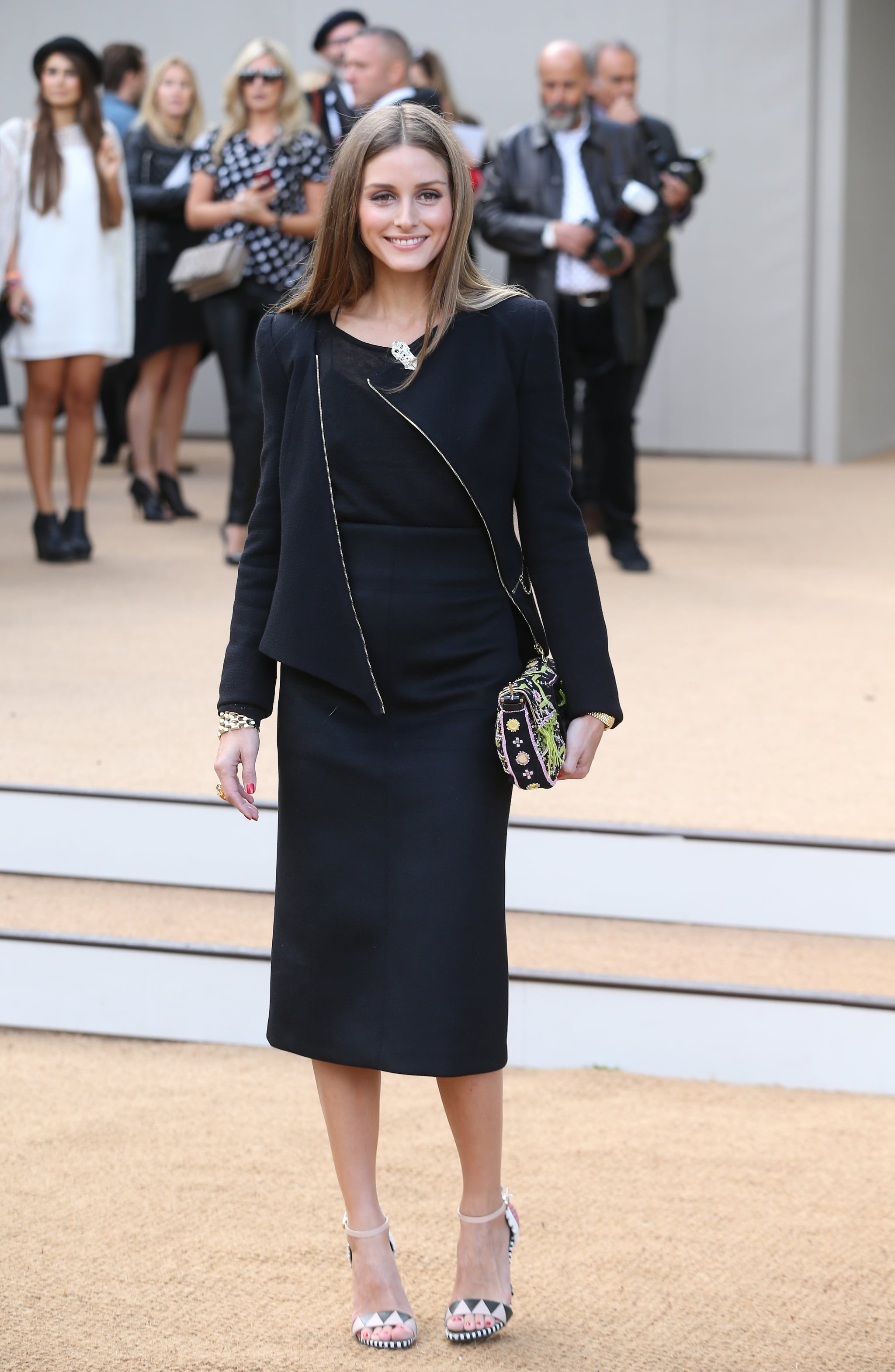 Olivia Palermo zipped up for the Burberry show.