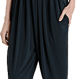 We love the refined halter neckline on this elegant Lanvin halter jumpsuit. Style tip: wear it with booties and a blazer for a daring daytime look.