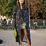 A duster and boots breathe new life into a pair of short shorts when the weather cools.